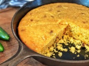 cheddar and jalapeño cornbread sliced in cast iron pan